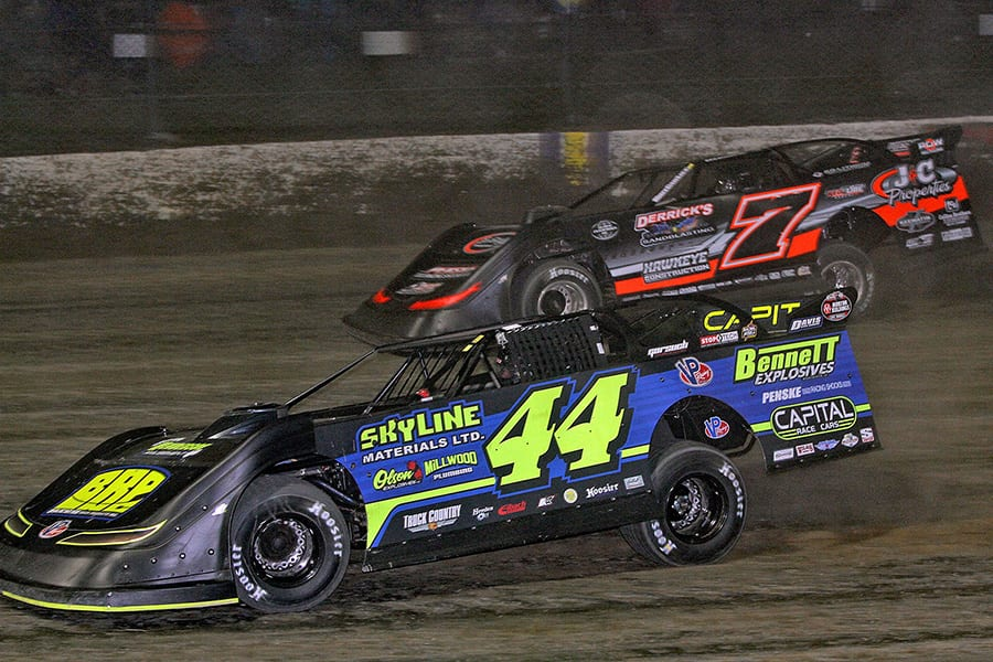 Chris Madden (44) races under Ricky Weiss during Thursday's second Dirt Late Model Dream preliminary feature at Eldora Speedway. (Jim Denhamer Photo)