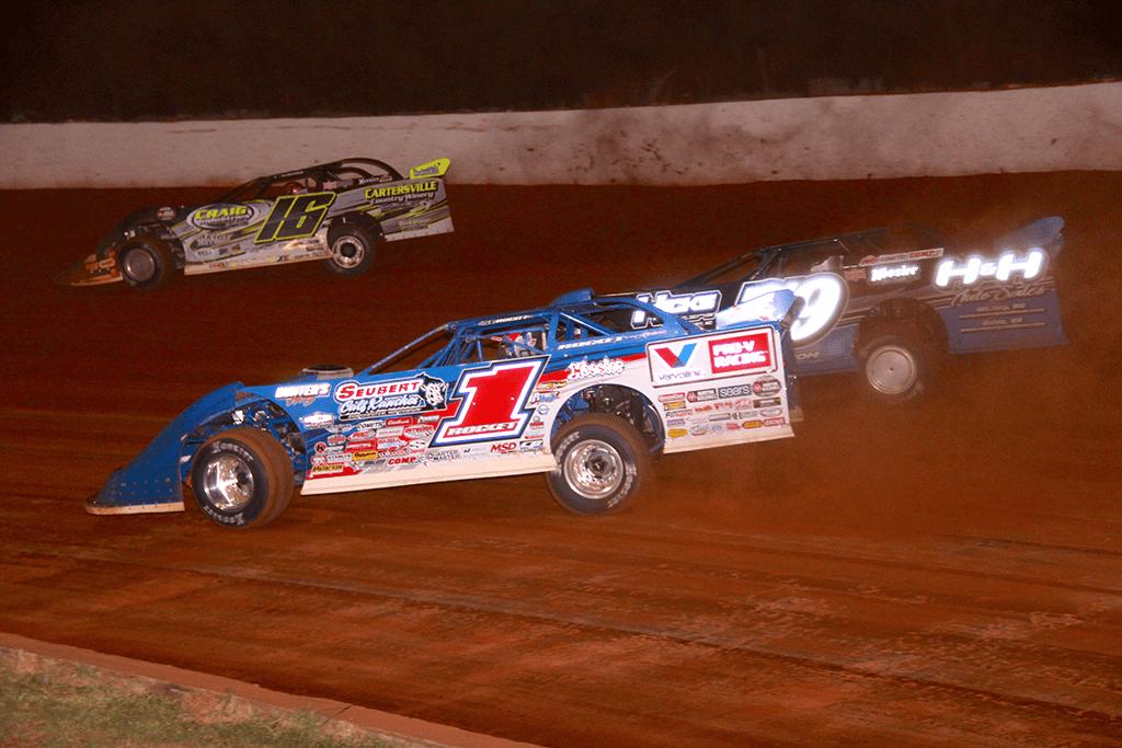 Brandon Sheppard (1) battles Ben Watkins (16) and Michael Brown at Lancaster Motor Speedway. (Justin Wilson photo)