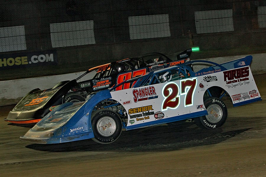 Eric Spangler (27) battles David Mielke during Saturday's American Ethanol Late Model Tour Fall Special at Hartford Speedway. (Jim Denhamer Photo)