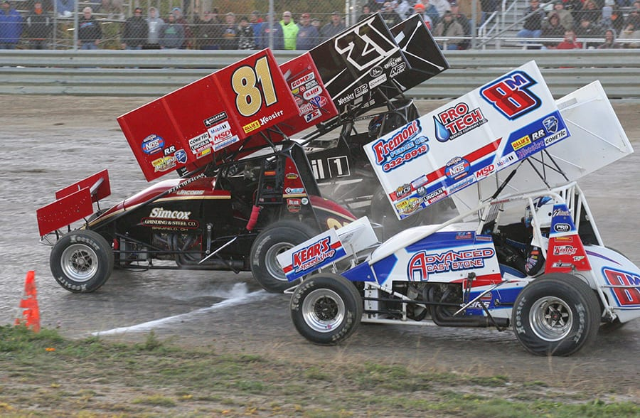 Christopher Bell (21), Lee Jacobs (81) and T.J. Michaels battle for position during Saturday's FAST Series Bob Hampshire Classic event at Waynesfield Raceway Park. (Todd Ridgeway Photo)