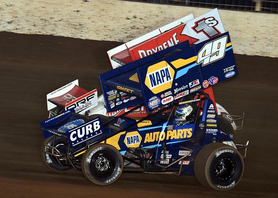 Brad Sweet battles Logan Schuchart during Saturday's World of Outlaws NOS Energy Drink Sprint Car Series finale at The Dirt Track at Charlotte. (Frank Smith Photo)