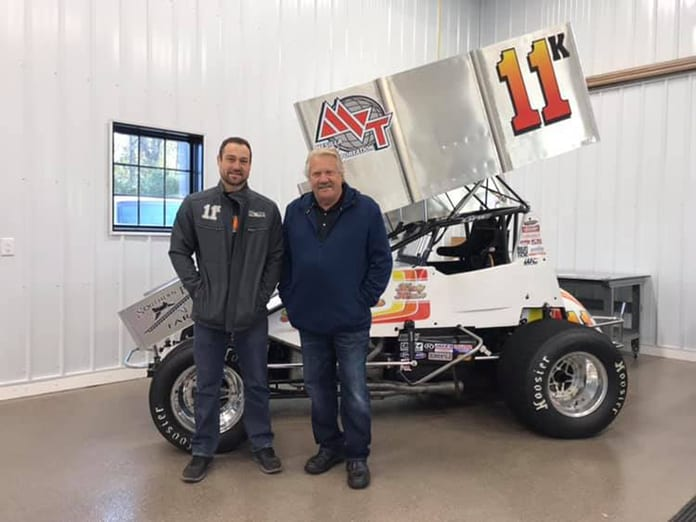 Kraig Kinser (left) and Steve Kinser (right) pose in front of Kraig Kinser's car that he will drive in the Can-Am World Finals at The Dirt Track at Charlotte.