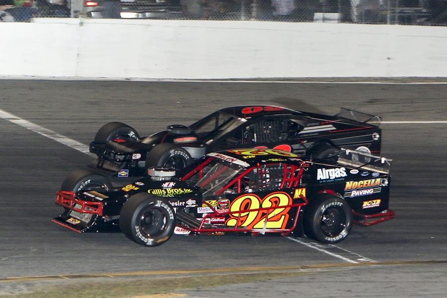 Anthony Nocella (92) battles Matt Hirschman for the race lead during Wednesday's John Blewett III Memorial 76 at New Smyrna Speedway. (Dick Ayers Photo)