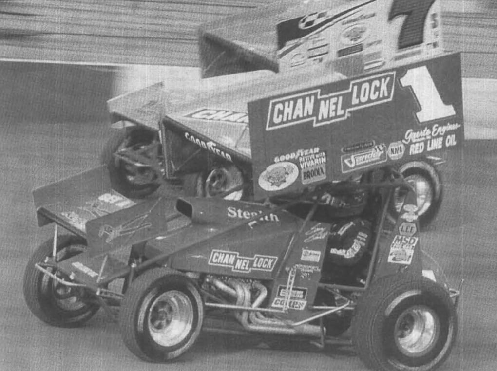 Sammy Swindell (1) races under Butch Schroeder during World of Outlaws action at Bristol (Tenn.) Motor Speedway in 2000. (Bob Hesser/NSSN Archives Photo)