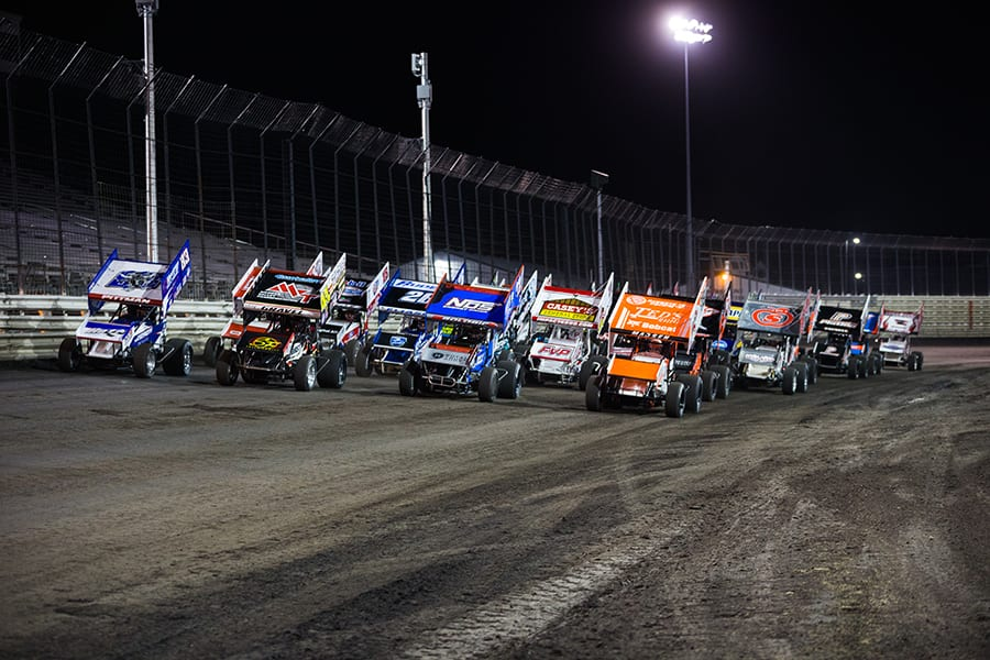 The field for Friday's World of Outlaws NOS Energy Drink Sprint Car Series event at Knoxville Raceway goes four-wide to salute the fans watching from home. (Trent Gower Photo)