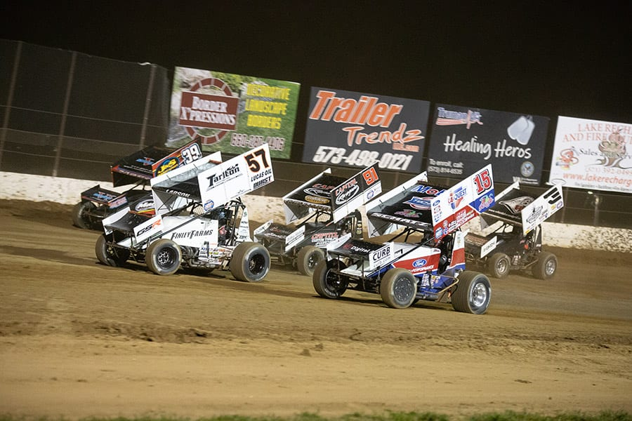 Drivers battle for position during Saturday's World of Outlaws NOS Energy Drink Sprint Car Series event at Lake Ozark Speedway. (Brad Plant Photo)