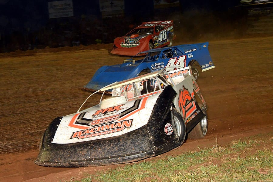 Mike Pegher Jr. (1c), Colten Burdette (44) and Colton Flinner race for position during Friday's Firecracker 100 preliminary event at Lernerville Speedway. (Hein Brothers Photo)