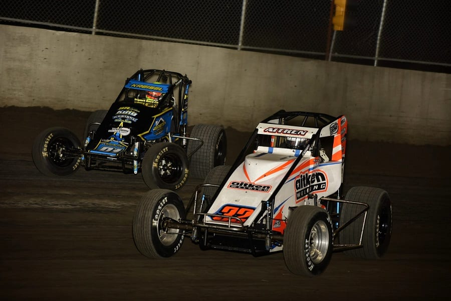 Riley Kreisel (91) chases Garrett Aitken during Friday's POWRi WAR Sprint League event at Tri-City Speedway. (Mark Funderburk photo)