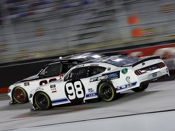 Chase Briscoe (98) races under Austin Cindric Friday night at Bristol Motor Speedway. (HHP/Andrew Coppley Photo)