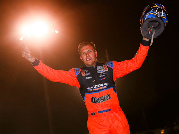 Nick Hoffman celebrates Friday night at Farmer City Raceway. (Josh James Photo)