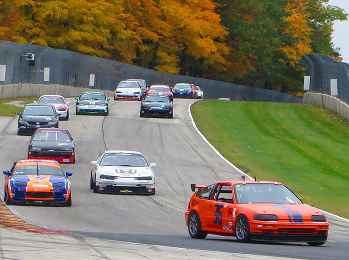 Joe Moser (36) leads the field into turn five during the Super Touring Lite class race as part of the 57th SCCA National Championship Runoffs on Sunday at Road America. (Nick Dettmann Photo)