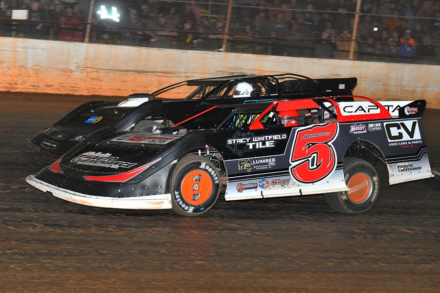 Ronnie Johnson (5) battles Matthew Turner during Saturday's Fall Nationals Series race at Boyd's Speedway. (Michael Moats Photo)