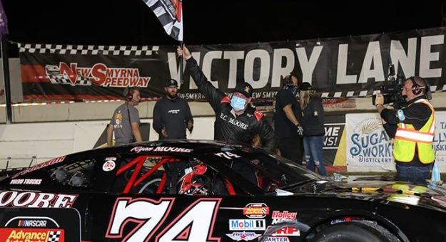 Ryan Moore celebrates after winning the opening super late model feature during the opening night of the World Series of Asphalt Stock Car Racing Friday at New Smyrna Speedway. (James DuPont Photo)