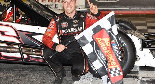 Craig Lutz in victory lane Monday at New Smyrna Speedway. (Jim DuPont Photo)