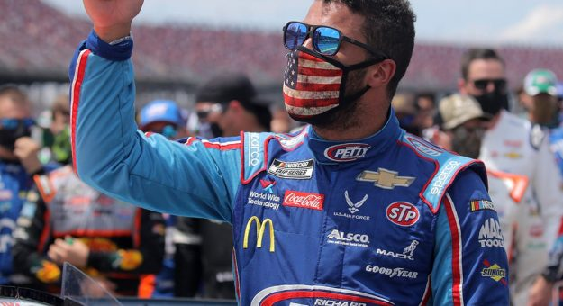 TALLADEGA, ALABAMA - JUNE 22: Bubba Wallace, driver of the #43 Victory Junction Chevrolet, gives a thumbs up prior to the NASCAR Cup Series GEICO 500 at Talladega Superspeedway on June 22, 2020 in Talladega, Alabama. A noose was found in the garage stall of NASCAR driver Bubba Wallace at Talladega Superspeedway a week after the organization banned the Confederate flag at its facilities. (Photo by Chris Graythen/Getty Images)