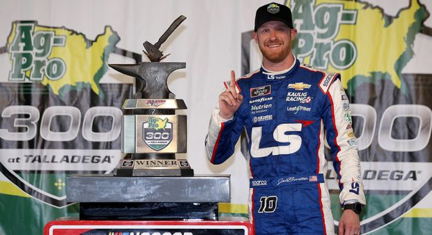 Jeb Burton poses in victory lane after winning Saturday's Ag-Pro 300 at Talladega Superspeedway. (Sean Gardner/Getty Images photo)