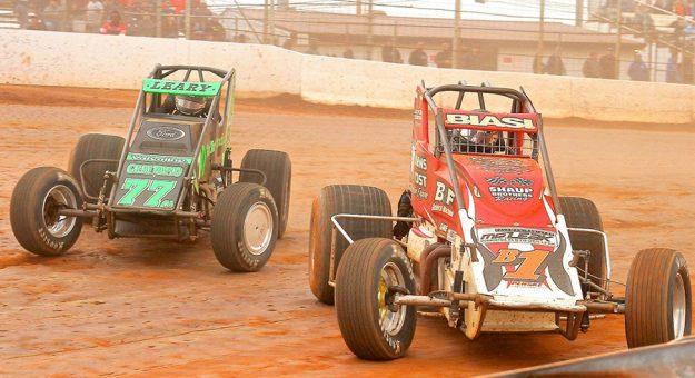 C.J. Leary (77) passes Joey Biasi Saturday at BAPS Motor Speedway. (Dan Demarco photo)