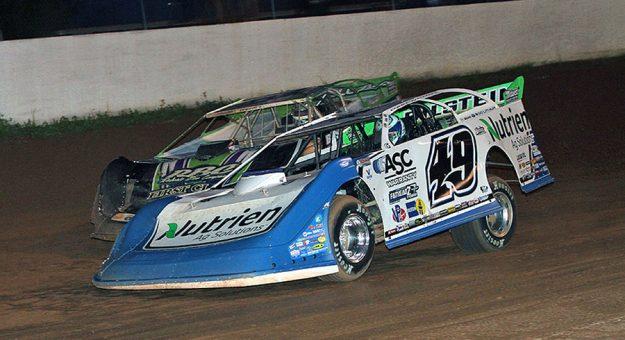 Jonathan Davenport (49) battles Tyler Erb Sunday at West Virginia Motor Speedway. (Jim Denhamer Photo)