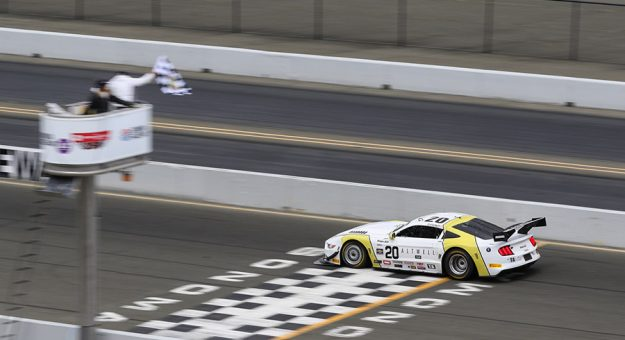 Chris Dyson takes the checkered flag to win Sunday's Trans-Am Series West Coast Championship event at Sonoma Raceway.