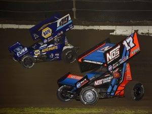 Sheldon Haudenschild (17) races alongside Brad Sweet Thursday at Jacksonville Speedway. (Mark Funderburk Photo)