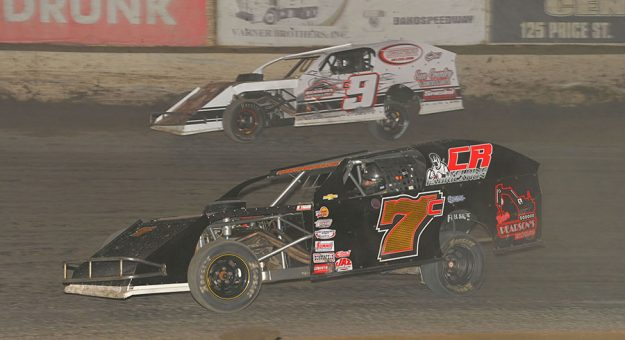 Clint Reichenbach (7c) races past Collen Winebarger Friday night at Bakersfield Speedway. (Tom Macht Photo)