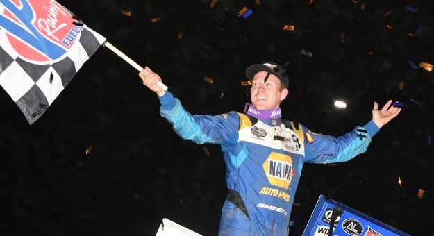 Brad Sweet celebrates in victory lane at I-70 Motorsports Park. (Ken Simon photo)