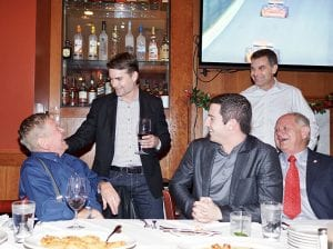 Bobby Unser (left) shares a laugh with Jeff Gordon as Alexander Rossi and Paul Page look on. (Bruce Martin Collection)
