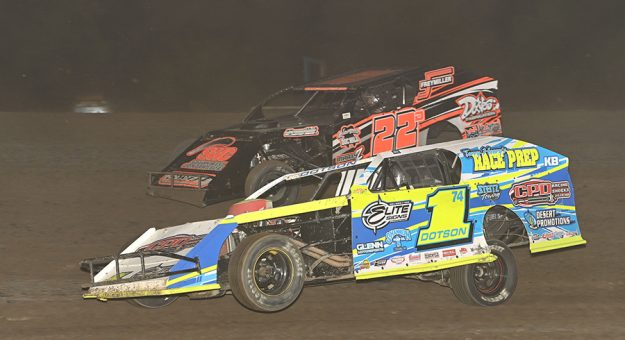 Ethan Dotson (1) drives by Ryan Daves Monday evening at Merced Speedway. (Tom Macht Photo)