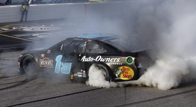 #19: Martin Truex Jr., Joe Gibbs Racing, Toyota Camry Auto-Owners Insurance celebrates his win