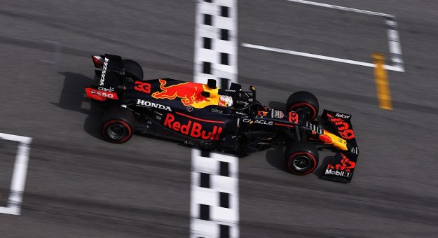 BARCELONA, SPAIN - MAY 09: Max Verstappen of the Netherlands driving the (33) Red Bull Racing RB16B Honda crosses the finish line for second place during the F1 Grand Prix of Spain at Circuit de Barcelona-Catalunya on May 09, 2021 in Barcelona, Spain. (Photo by Lars Baron/Getty Images) // Getty Images / Red Bull Content Pool  // SI202105090685 // Usage for editorial use only //   Getty Images