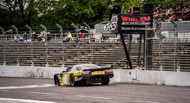 Cody Coughlin takes the checkered flag Saturday at Nashville Fairgrounds Speedway. (Jason Reasin Photo)
