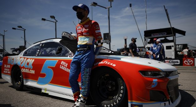 DARLINGTON, SOUTH CAROLINA - MAY 09: Kyle Larson, driver of the #5 HendrickCars.com Throwback Chevrolet, waits on the grid prior to the NASCAR Cup Series Goodyear 400 at Darlington Raceway on May 09, 2021 in Darlington, South Carolina. (Photo by Chris Graythen/Getty Images) | Getty Images