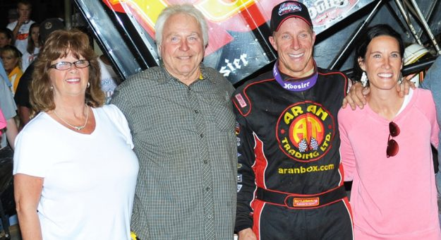 Steve Smith (second from left) with his son Stevie Smith at Williams Grove Speedway. (Julia Johnson Photo)