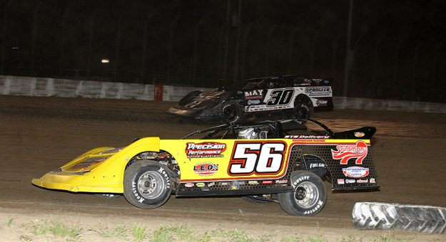 Andy Eckrich (56) battles Todd Cooney Friday at Davenport Speedway. (MIke Ruefer Photo)