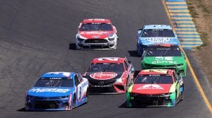 Kyle Larson (5) passes William Byron (24) as they race through traffic Sunday at Sonoma Raceway. (Carmen Mandato/Getty Images Photo)