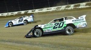 Jonathan Davenport (49) races ahead of Jimmy Owens Thursday at Eldora Speedway. (Paul Arch Photo)