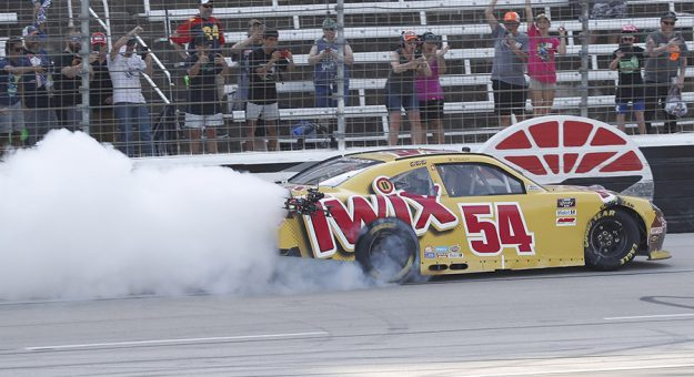 Kyle Busch celebrates after winning Saturday's NASCAR Xfinity Series race at Texas Motor Speedway. (HHP/Harold Hinson Photo)