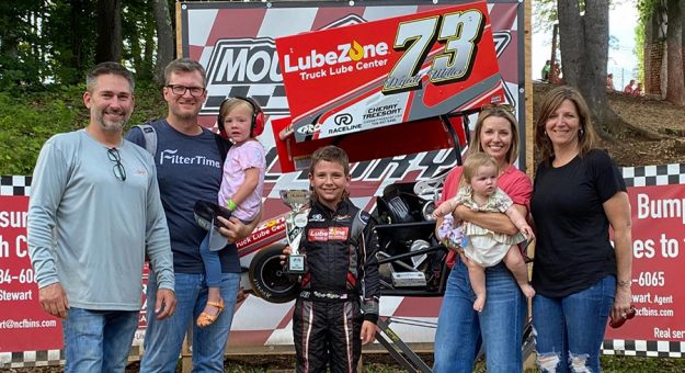 Wyatt Miller (center) won Box Stock feature at Mountain Creek Speedway Sunday and was joined in victory lane by his parents, L.W. Miller and Kelley Earnhardt-Miller, as well as Dale Earnhardt Jr. and his wife, Amy. (Earnhardt Collection)