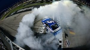 Kyle Larson celebrates with a burnout after his victory in the NASCAR All-Star Race. (Sean Gardner/Getty Images Photo)