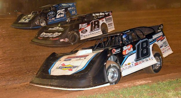 Chase Junghans (18), Shannon Babb (18B) and Mason Zeigler race three-wide during Friday's Firecracker 100 preliminary event at Lernerville Speedway. (Hein Brothers Photo)