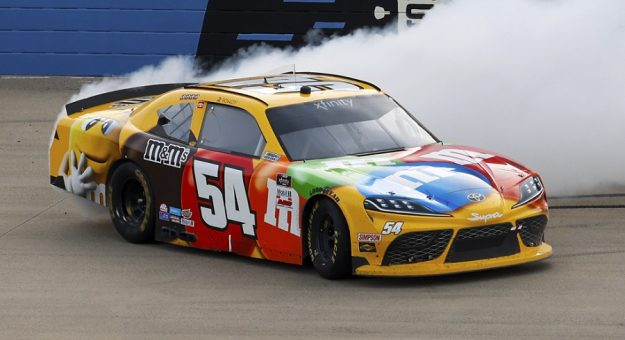 #54: Kyle Busch, Joe Gibbs Racing, Toyota Supra M&M's celebrates his 100th Xfinity Series win