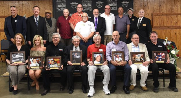 The 2021 class of the National Sprint Car Hall of Fame & Museum poses with other living inductees in June. (Paul Arch Photo)