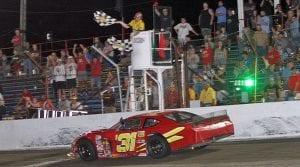 Kyle Crump takes the checkered flag to win the Redbud 400. (Jim Denhamer Photo)