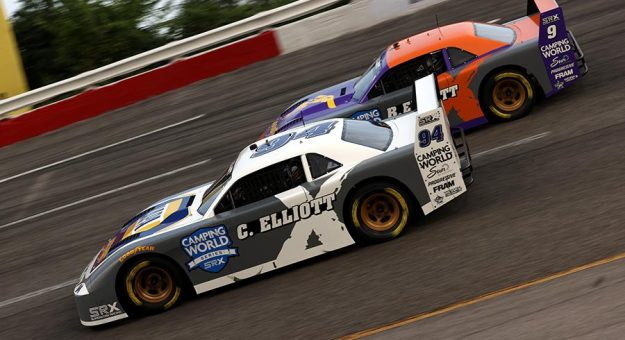 Chase Elliott (94) races to the inside of his father Bill Elliott Saturday night at Nashville Fairgrounds Speedway. (Dylan Buell/SRX via Getty Images Photo)