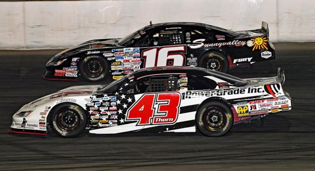 Derek Thorn (43) battles Jacob Gomes in the opening laps of Saturday's SPEARS SRL Southwest Tour race at Irwindale Speedway. (Steve Himelstein Photo)