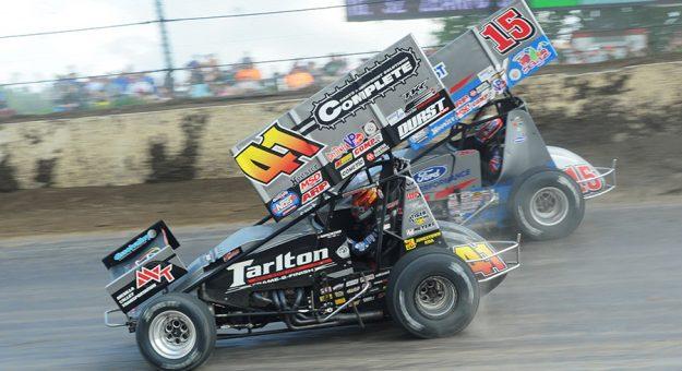 Carson Macedo (41) races Donny Schatz Saturday at Eldora Speedway. (Julia Johnson Photo)