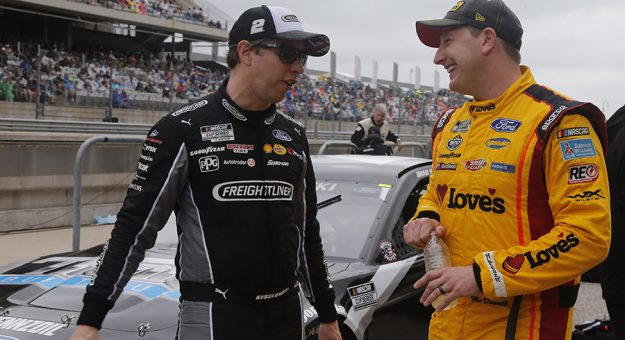 Brad Keselowski (left) chats with Michael McDowell at Circuit of the Americas. (HHP/Tim Parks Photo)