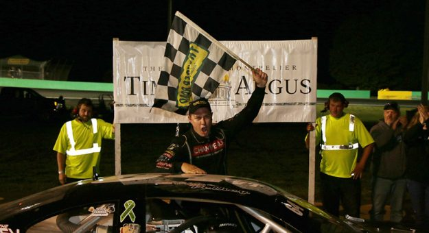 A jubilant Christopher Pelkey emerges from his car after winning the Maplewood/Irving Oil Late Model feature at the Times Argus Midseason Championships on Thursday, July 22. (Alan Ward photo)