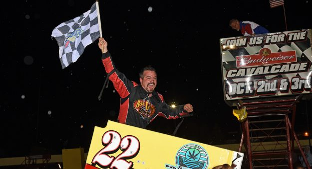 Mike McVetta celebrates his victory in the Hy-Miler at Sandusky Speedway. (JIm Feeney Photo)