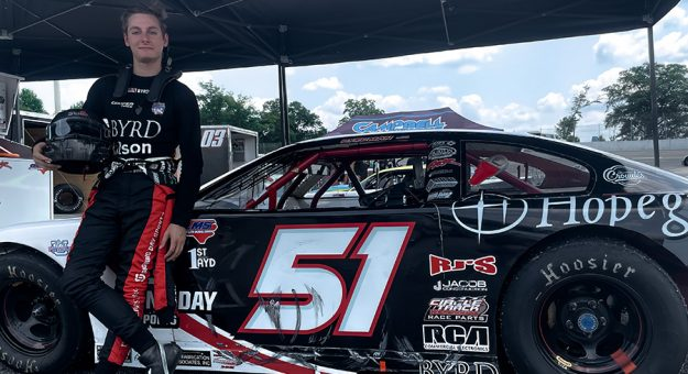 Nathan Byrd poses beside his pro late model at Dillon (S.C.) Motor Speedway.